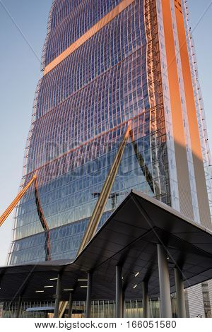 MILAN, ITALY - NOVEMBER 7, 2016: Milan (Lombardy Italy): modern glass skyscraper in Citylife (Tre Torri) known as the Allianz building at sunset