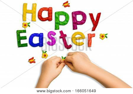 Words fashioned from clay Happy Easter on white background and children's hands