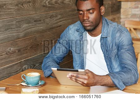 Modern Technology And Communication. Stylish African Student Surfing Internet On Digital Tablet, Enj