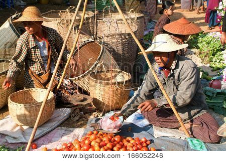 Indein Myanmar - 15 January 2010: people on traditional clothes at the weekly market at Indein on Inle Lake in Myanmar