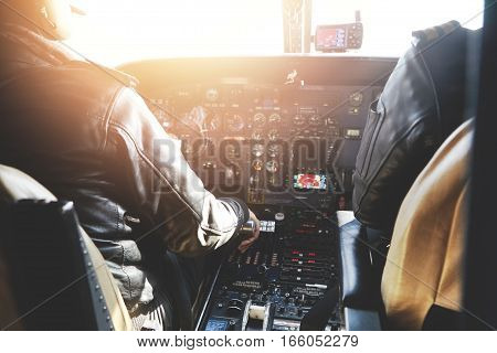 Aerospace, Transport And People. Two Pilots Dressed In Uniform Flying Jet Airliner On Sunny Day, Sit
