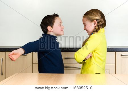 Cute little boy spreading arms wide open to hug pretty girl