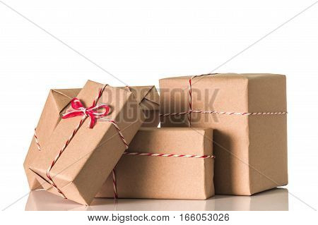 Gift box wrapped in brown paper isolated on white background