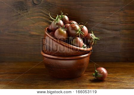 Cherry tomatoes in a ceramic bowl, selective focus