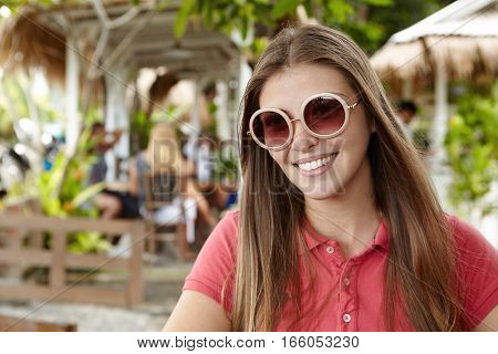Good-looking Young Female Student With Long Loose Hairstyle Spending Sunny Day At Sidewalk Restauran
