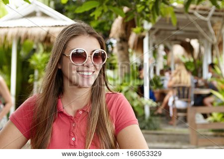 Happy Young Caucasian Business Lady Wearing Polo Shirt And Trendy Sunglasses Enjoying Summer Vacatio
