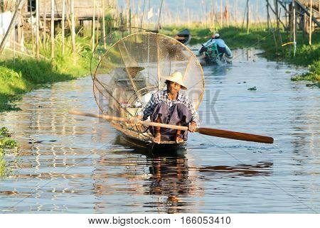 Lake Inle Myanmar - 15 January 2010: Fishermen fishing on his boat at lake Inle Myanmar
