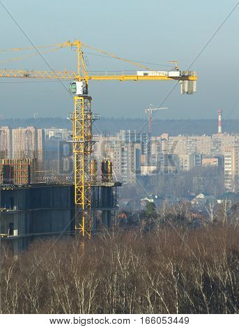 Hoisting tower cranes constructs new city building and residential houses