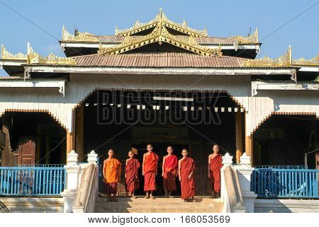 Lake Inle Myanmar - 14 January 2010: young monks posing in front of Maing Thauk forest monastery on Myanmar