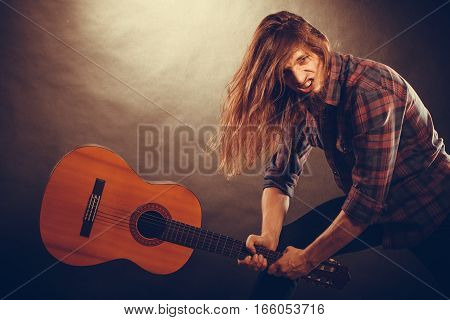 Rock Musician Destroys His Guitar.