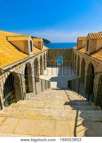 Dubrovnik, Croatia - June 07, 2015: View on the fortress and marina in the old town of Dubrovnik, Croatia. Dubrovnik is a UNESCO World Heritage site