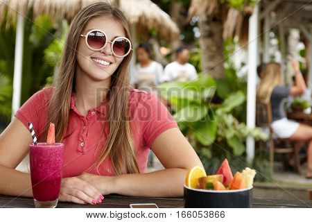 Fashionable Pretty Girl With Long Hairstyle And Cute Smile Wearing Polo Shirt And Round Sunglasses R