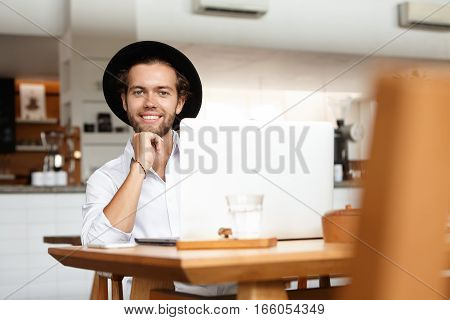 Technologies Make Life Easier. Portrait Of Cheerful Young Man Smiling Joyfully, Happy With His Newly