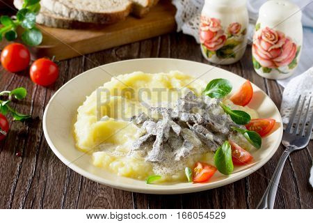 Traditional Hot Meat Stew With Sour Cream And Garnish Mashed Potatoes On A Wooden Table. Concept Of