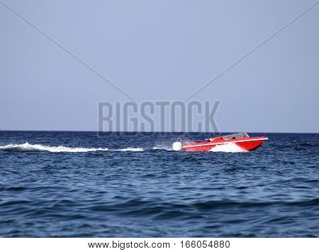 Red power boat on the river Dniepro, Kyiv, Ukraine
