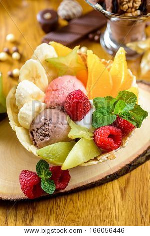 Ice cream with fruit and chocolate decorated with candies and berries