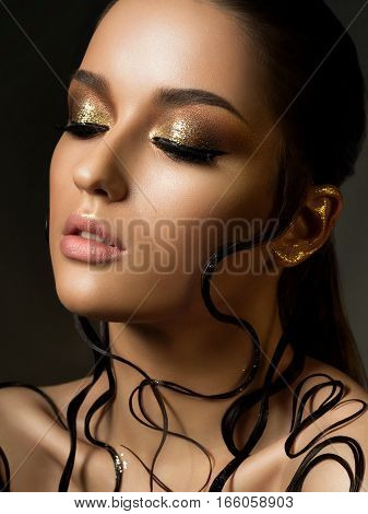 Woman With Fashion Golden Makeup