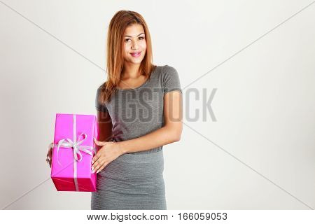 Woman mixed race with gift. Girl with pink box.