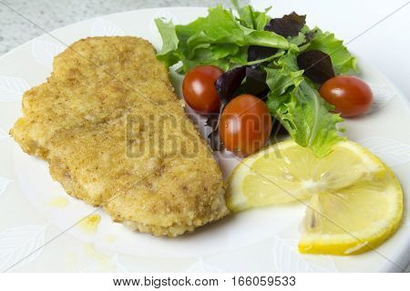 Swordfish Steak With Salad, Tomatoes And Lemon