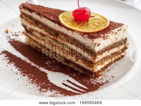 Chocolate beautiful cake with cherry and cream