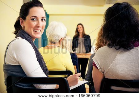 a group of women are attending a lecture