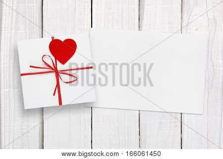 Valentines Day card and gift box on white table