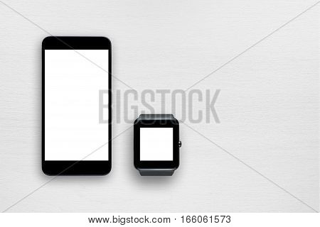 Smartphone and smartwatch on white table top view