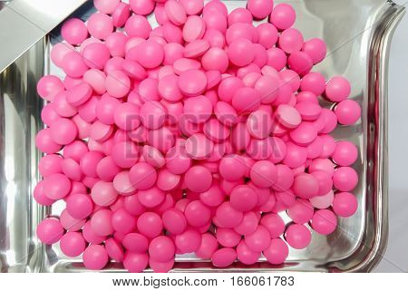 Pink Medicine Capsules On Stainless Steel Drug Tray, Pills And Spatula