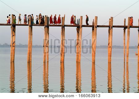Amarapura Myanmar - 17 January 2010: People walking on the wooden bridge of U Bein on river Ayeyarwad Myanmar
