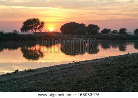 Sunset at river Ayeyarwady near Mandalay on Myanmar