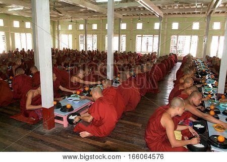Mandalay Myanmar 17 January 2010: Monks eating at Mahagandayon Monastery in Mandalay Myanmar