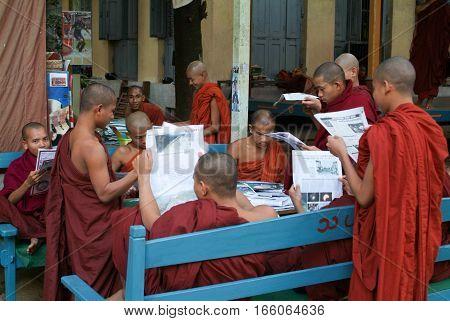 MANDALAY MYANMARMAY - 19 January 2010: Monks reading newsparers at the Shwe in Bin Kyaung monastery of Mandaley on Myanmar