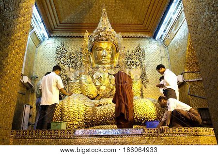 MANDALAY MYANMARMAY - 19 January 2010: The Myanmar people venerated Buddha statue with the golden paper at Mahamuni Buddha temple in Mandalay Myanmar.