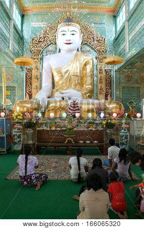 Sagaing Myanmar - 17 January 2010: believers in prayer in front of the statue of Buddha at Soon U Ponya Shin pagoda in Sagaing on Myanmar