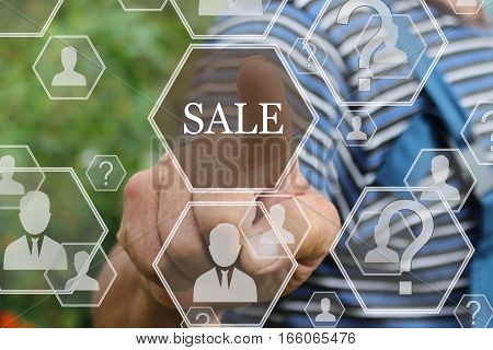Farmer businessman  pushes a button SALE on the touch screen the web . The concept of online auctions, shopping, real estate .