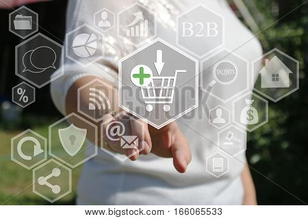 The businesswoman clicks on the shopping cart web on the touch screen the web network . The concept of online auctions.