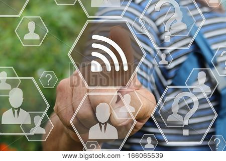 Farmer businessman pushes button WI - FI  icon on the touch screen .Business network RSS. Tanned hands, male hands of an elderly person.