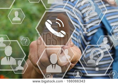 Farmer businessman presses the button web telephone on the touch screen in the web network.The concept of doing business and shopping by using online communication.Tanned hands, male hands.
