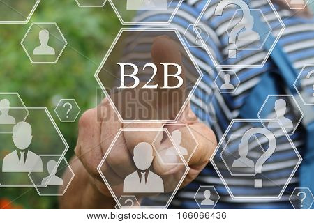 Farmer businessman  pressing button B2B  on virtual screens in the web network.The concept of The business consultant .Tanned hands, male hands of an elderly person.