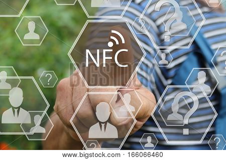 Farmer businessman The businessman clicks on the NFC  icon on the touch screen the web network .Tanned hands, male hands of an elderly person.