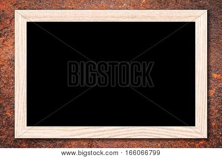 Blackboard or Empty bulletin board with a wooden frame on rusty metal background with copy space for text or image.