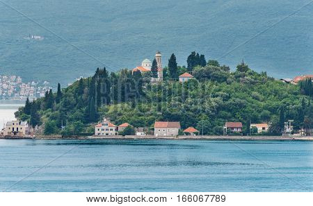 Small village and cathedral along the Bay of Kotor in Montenegor