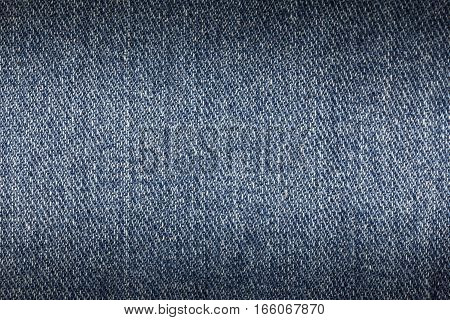 Denim jeans texture or denim jeans background. Old grunge vintage denim jeans. Stitched texture denim jeans background of fashion jeans design. Dark edged.