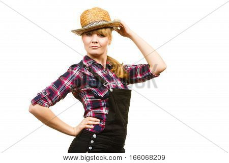 Gardening concept. Smiling attractive woman in pink check shirt sun hat and black dungarees making shocked face expression. Isolated background