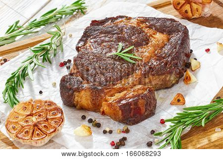 Grilled Rib-eye Steak With Garlic And Rosemary On Paper