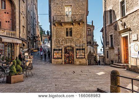 San Marino Republic of San Marino - June 15 2016: Tourists stroll through the small shopping village and town square in the Republic of San Marino