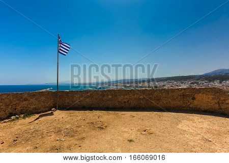 Rethymnon Island Crete Greece - June 23 2016: View on the inside part of Fortezza Castle in Rethymnon and the national flag of European country Greece