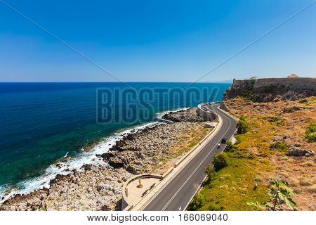 Rethymnon Island Crete Greece - June 23 2016: View on the high stone wall of Fortezza Castle in Rethymnon.
