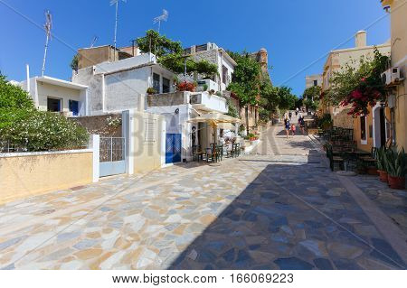 Rethymnon Island Crete Greece - June 23 2016: The narrow street of Rethymnon (part of Old Town) where there are a lot of small cafes and shops