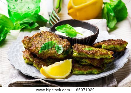 Broccoli Fritters with yogurt sauce .selective focus
